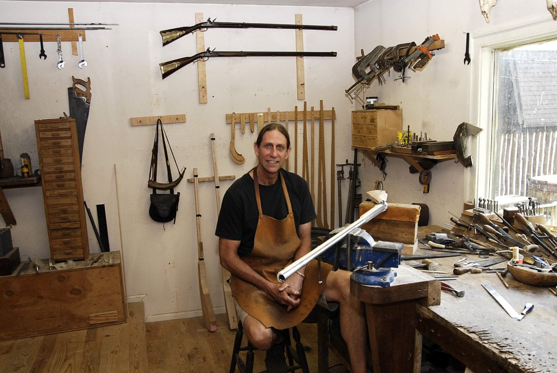 Tim Williams takes a break in his shop where he is building a .58 caliber flintlock rifle.